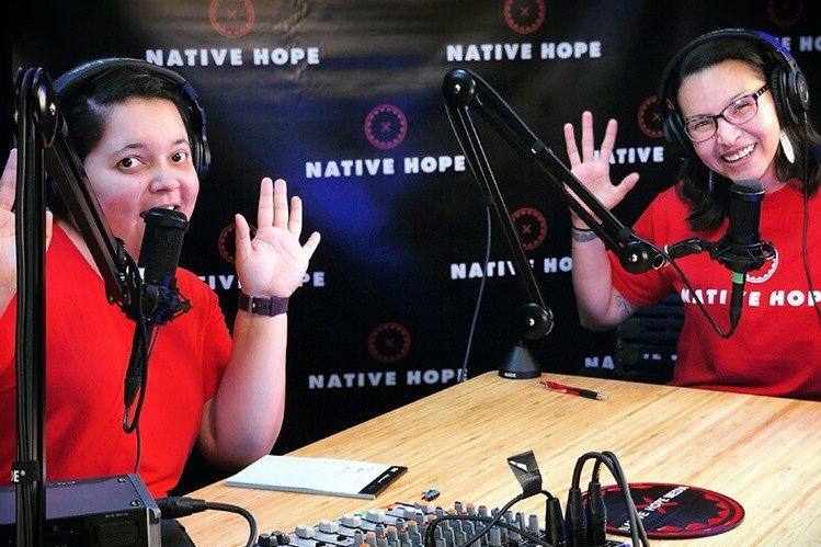 two-women-wearing-native-hope-shirts-with-microphones